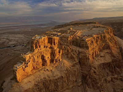 Herod's three-tiered palace cascades down the north face of Masada Photographic Print by Michael Melford