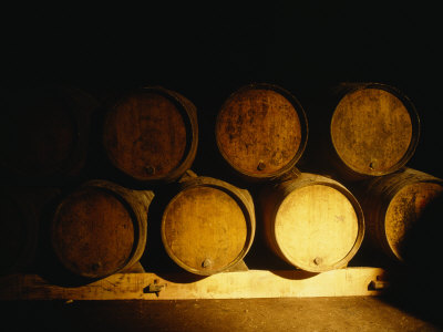 Barrels in a Cellar, Chateau Pavie, St. Emilion, Bordeaux, France Photographie