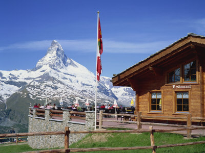 Tourists on the Balcony of the Restaurant at Sunnegga Looking at the Matterhorn in Switzerland Photographic Print by Rainford Roy