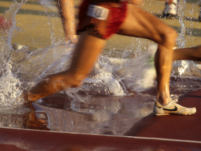 Detail of Runners Feet in Water Jump of Steeplechase Race Photographic Print