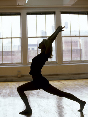 Young Women Stretching During Exercise Session, New York, New York, USA Photographic Print by Chris Trotman