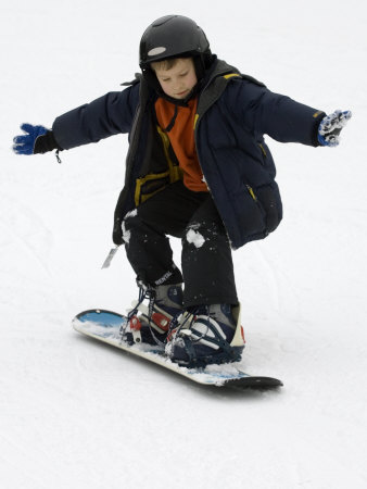 9 Year Old Boy Riding His Snowboard, New York, USA Photographic Print by Paul Sutton