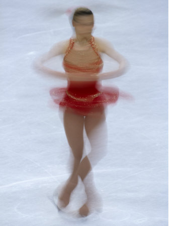 Female Figure Skater Preforming a Spin Photographic Print
