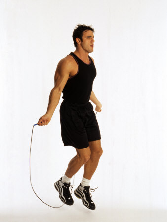 Young Man Working Out with Jump Rope Fotografisk tryk af Chris Trotman