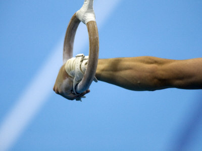 Detail of Male Gymnast Competing on the Rings, Athens, Greece Photographic Print by Steven Sutton