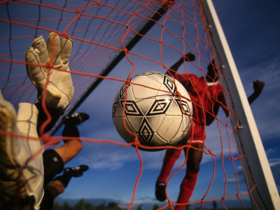 Soccer Player Scoring a Goal Photographic Print
