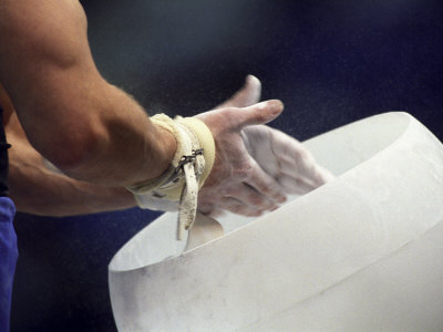 Detail of the Hands of Male Gymnast Preparing for Competition Photographic Print by Paul Sutton