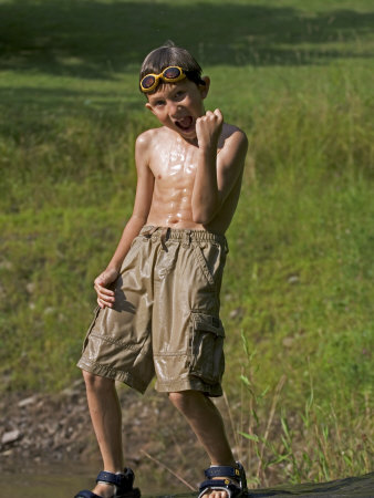 9 Year Old Boy Posing on a Rock Next to a Pond, Woodstock, New York, USA Photographic Print by Paul Sutton