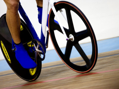Detail of Cyclist Racing on the Velodrome Track, Athens, Greece Photographic Print by Paul Sutton