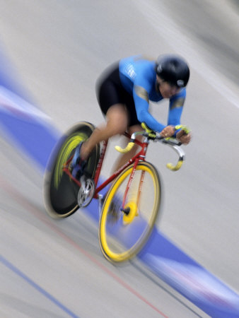 Blured Action of Female Cyclist Competing on the Velodrome Photographic Print