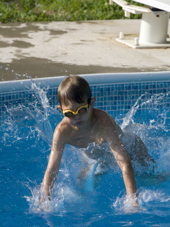 9 Year Old Boy Diving into a Swimming Pool, Woodstock, New York, USA Photographic Print by Paul Sutton