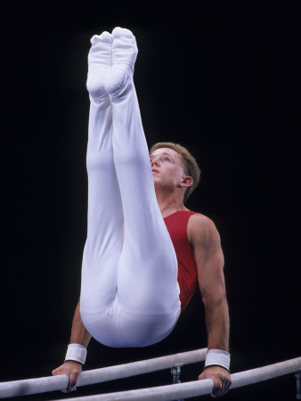 Male Gymnast Performing on the Parallel Bars Photographic Print