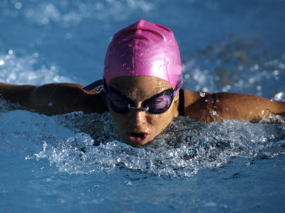 Woman in Action During a Butterfly Swimming Race Photographic Print