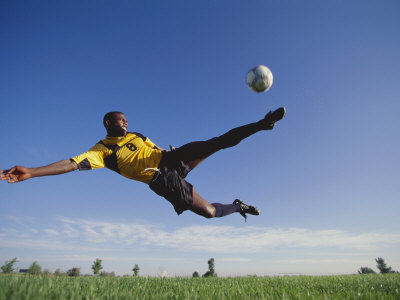 Soccer Player in Action Photographic Print