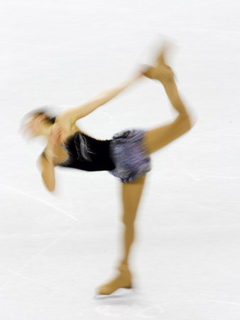 Blurred Action of Woman Figure Skater, Torino, Italy Fotografisk tryk af Chris Trotman