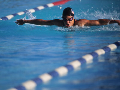 Female Swimmer Competing in a Butterfly Race Photographic Print