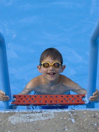 Portrait of 9 Year Old Boy in Swimming Pool, Kiamesha Lake, New York, USA Photographic Print by Paul Sutton