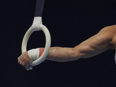 Detail of the Hands of Male Gymnast Grabing the Ring Photographic Print by Paul Sutton