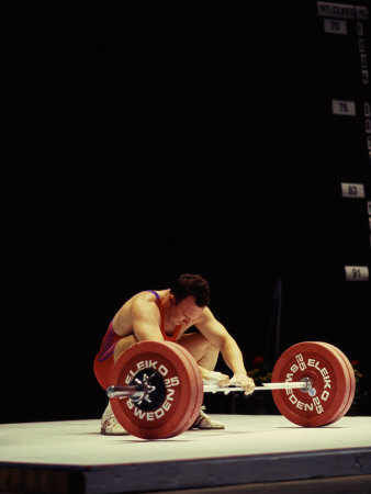 Weightlifter in Action Photographic Print