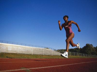 Female Runner Training on the Track Photographic Print