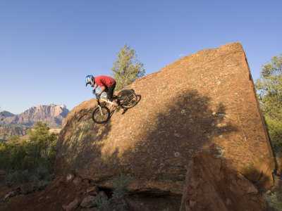 Mountain Biker on Natural Wall Ride, Rockville, Utah, USA Photographic Print by Chuck Haney