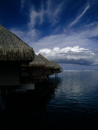 Hotel Bungalows over Water at an Exclusive Resort on Tahiti Photographic Print by Paul Sutherland