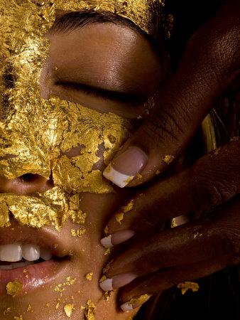 Woman Receiving a Gold Facial Photographic Print by Randy Olson