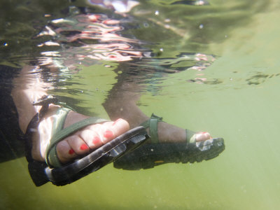 Woman's Feet Hang in the Clear Waters of the Colorado River Photographic Print by Pete McBride