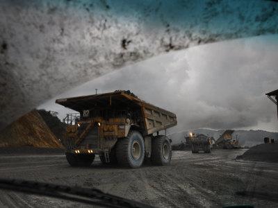 Trucks Hauling Waste Rock at Batu Hijau, a Copper and Gold Mine Photographic Print by Randy Olson