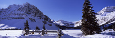 Bridge Covered with Snow, Bow Lake, Mt Thompson, Portal Peak, Banff National Park, Alberta, Canada Photographic Print by  Panoramic Images