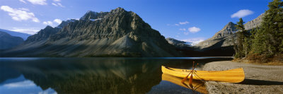 Canoe at the Lakeside, Bow Lake, Banff National Park, Alberta, Canada Photographic Print by  Panoramic Images