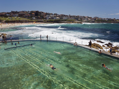 Swimmers Do Laps at Ocean Filled Pools Flanking the Sea at Sydney's Bronte Beach, Australia Photographic Print by Andrew Watson