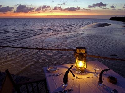 Sunset Dining on the Jetty, Fundu Lagoon Resort, Pemba Island, Zanzibar, East Africa Photographic Print by Paul Harris