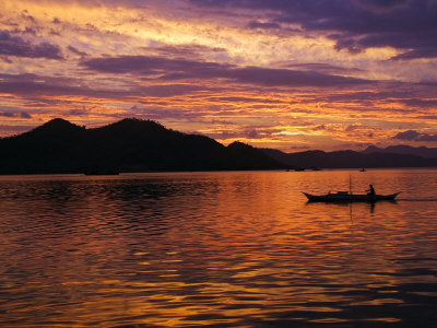 Palawan Province, Busuanga Island, Coron Town, Sunset over Coron Bay and Fishing Boat, Philippines Photographic Print by Christian Kober