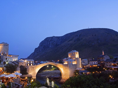 Balkans Bosnia Mostar Stari Most Peace Bridge on Neretva River Lit Up in the Evening Photographic Print by Christian Kober