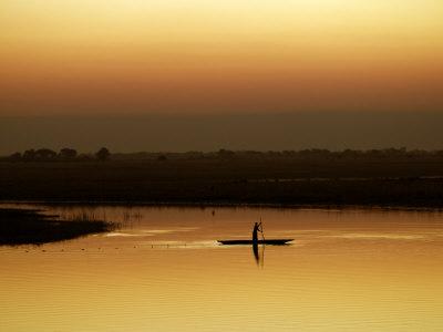 Fisherman at Sunset on the Chobe River, Botswana Photographic Print by Nigel Pavitt