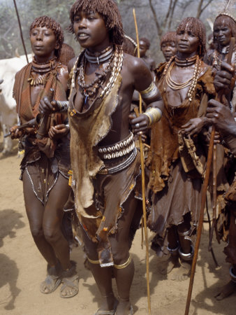 Hamar Women Dance, Sing and Blow Tin Trumpets in 'Jumping of Bull' Ceremony, Omo Delta, Ethiopia Photographic Print by Nigel Pavitt