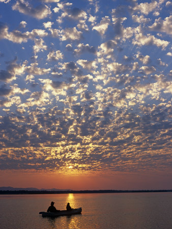 Canoeing under a Mackerel Sky at Dawn on the Zambezi River, Zambia Photographic Print