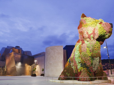 The Guggenheim, Designed by Architect Frank Gehry, and Puppy, the Sculpture by Jeff Koons Photographic Print by Christian Kober