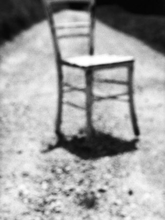 Empty Straight-Backed Chair in Spotlight Photographic Print