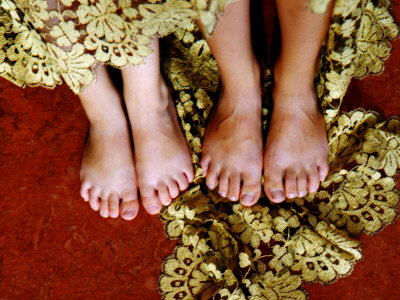 Two Pair of Feet of Small Children with Textile Spread around Them Photographic Print by Winfred Evers