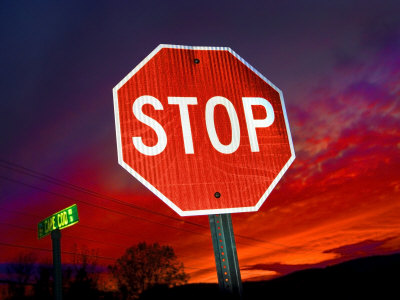 Stop Sign with an Intense Red Sunset in the Backround Photographic Print by John Churchman