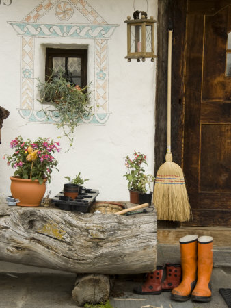 Boots, a Broom and Flowers Outside a Chalet Photographic Print by Annie Griffiths Belt