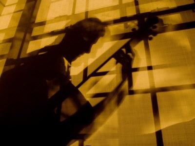 Shadow of a Man Playing Guitar Photographic Print by John Churchman