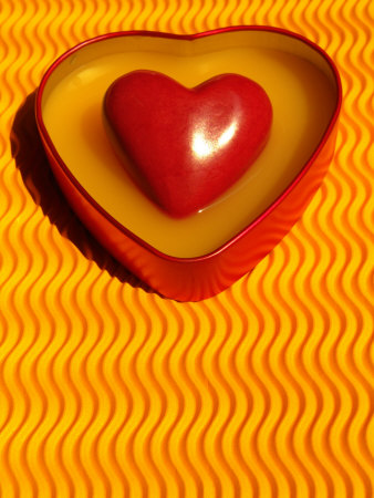 A Love Stone Heart with Yellow Background Photographic Print by Abdul Kadir Audah