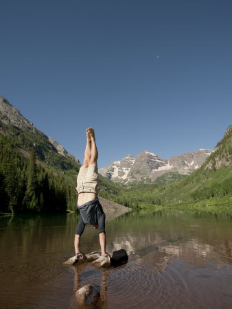Agile Young Man Practicing Yoga in a Mountain Lake Landscape Photographic Print by Pete McBride