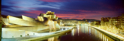 Buildings Lit Up at Dusk, Guggenheim Museum Bilbao, Bilbao, Vizcaya, Spain Photographic Print by  Panoramic Images