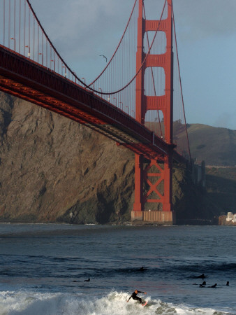 Surfer Rides a Wave Near the Golden Gate Bridge in San Francisco Photographic Print