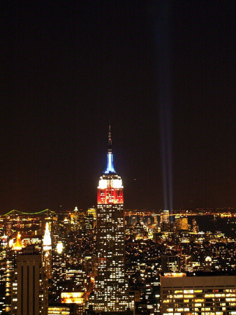 Empire State Building in Red, White and Blue as Columns of Light Soar from World Trade Center Site Photographic Print