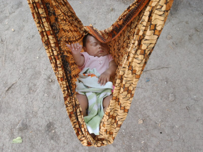 Four-Month-Old Rianto Sleeps in a Batik Cloth Swing, at a Refugee Camp in Lamreh, Indonesia Photographic Print
